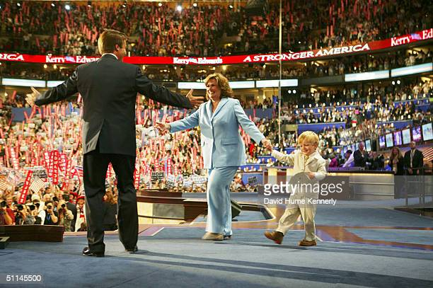 Vice presidential nominee Senator John Edwards welcomes his wife Elizabeth and son Jack onto the stage after his acceptance speech at the Democratic...