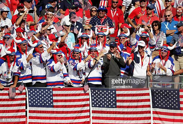 Vicecaptain Bubba Watson of the United States cheers with fans in the first grandstand during singles matches of the 2016 Ryder Cup at Hazeltine...