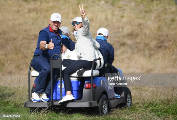 ViceCaptain Lee Westwood of Europe and girlfriend Helen Storey on a buggy during the afternoon foursome matches of the 2018 Ryder Cup at Le Golf...