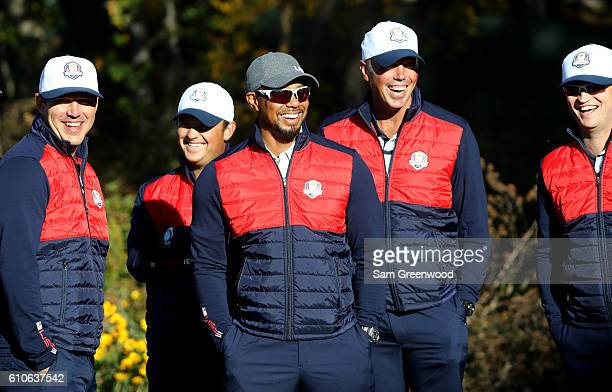 Vice-captain Tiger Woods laughs with Brooks Koepka, Patrick Reed, Matt Kuchar and Zach Johnson during team photocalls prior to the 2016 Ryder Cup at...