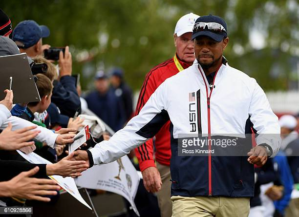 Vicecaptain Tiger Woods of the United States high fives fans during practice prior to the 2016 Ryder Cup at Hazeltine National Golf Club on September...