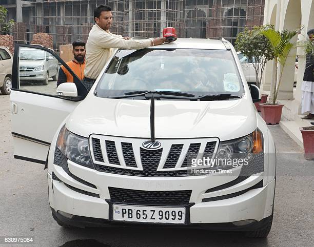 ViceChairman of the National Commission for SC and Congress MLA Raj Kumar Verka's driver removing the red beacon top of the car after an election...
