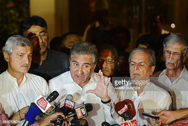 Vicechairman of the opposition Pakistan TehreekeInsaaf party Shah Mehmood Qureshi speaks to media alongside party leaders after a meeting with a...