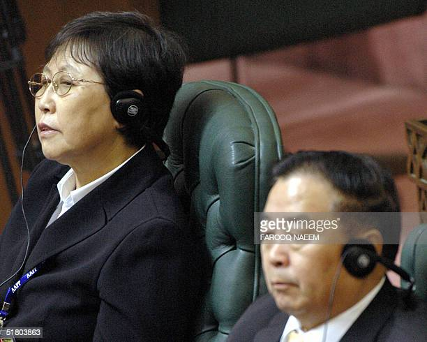 ViceChairman of the standing committee of the National People's Congress of China Wuyunqimuge listens to the president of the Association of Asian...