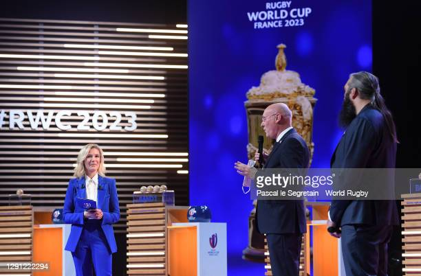 Vice-Chairman of World Rugby Bernard Laporte and France 2023 ambassador, Sebastien Chabal speak on stage during the Rugby World Cup France 2023 draw...