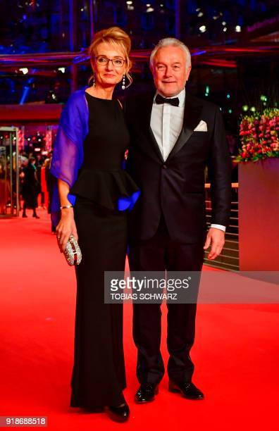 FDP ViceChairman Wolfgang Kubicki and his wife Annette MarberthKubicki pose on the red carpet for the opening ceremony of the 68th Berlinale film...