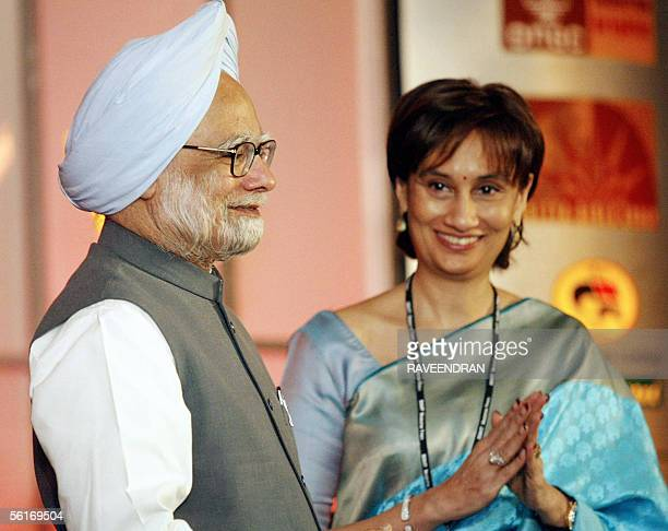 ViceChairperson and Editorial Director of India's newspaper the Hindustan Times Shobhana Bhartia greets Indian Prime Minister Manmohan Singh during a...