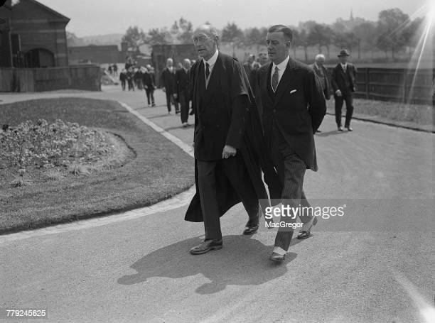 Vicechancellor of Birmingham University Grant Robertson and British mining engineer Sir John Cadman walking to the new Department of Petroleum...