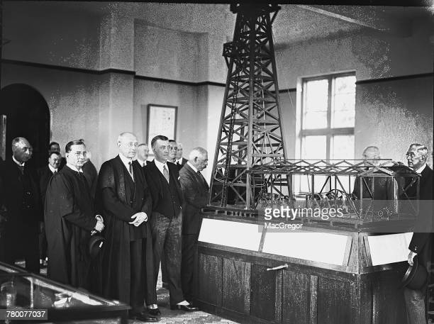 Vicechancellor of Birmingham University Grant Robertson and British mining engineer Sir John Cadman with an instructional model of an oil...
