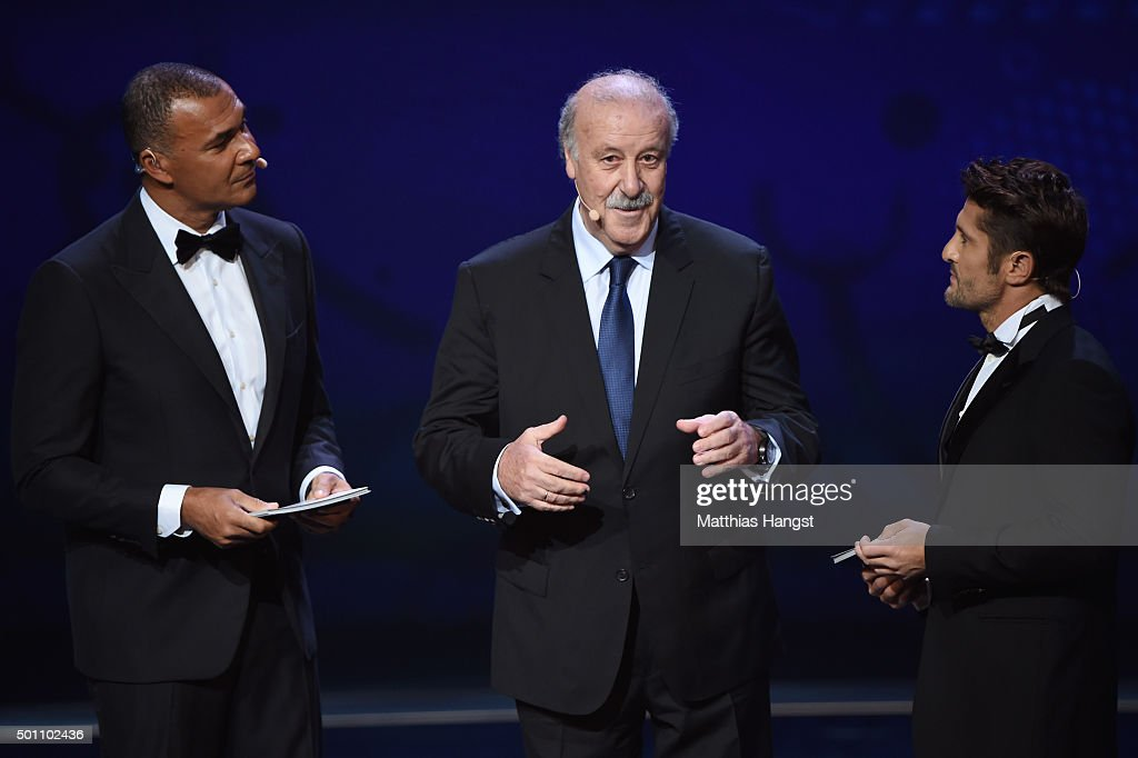 Vicente del Bosque (C) Manager of Spain talks with host Ruud Gullit (L) and Bixente Lizarazu (R) on stage during the UEFA Euro 2016 Final Draw Ceremony at Palais des Congres on December 12, 2015 in Paris, France.