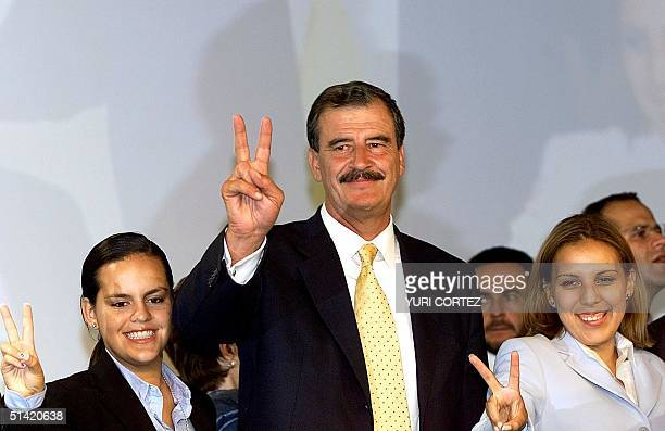 Vicente Fox, the new Mexican president-elect, accompanied by his daughters Pauline and Cristina , makes the victory sign during a press conference in...