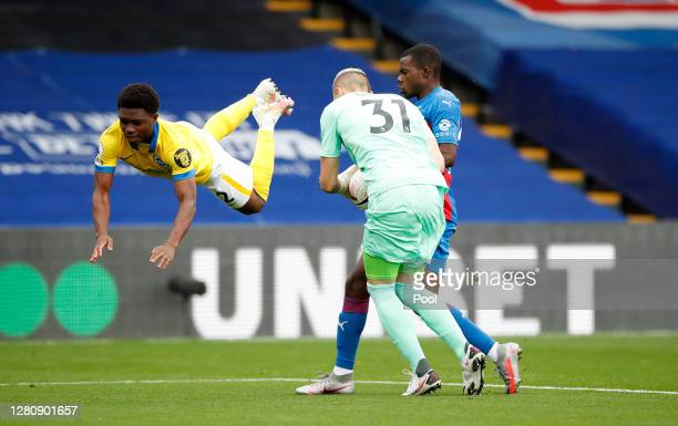 Vicente Guaita and Tyrick Mitchell of Crystal Palace collide with Tariq Lamptey of Brighton and Hove Albion during the Premier League match between...