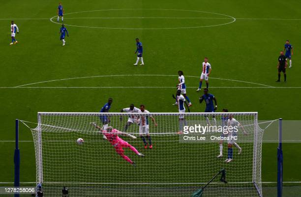 Vicente Guaita of Crystal Palace dives for the ball as Kurt Zouma of Chelsea scores his sides second goal during the Premier League match between...