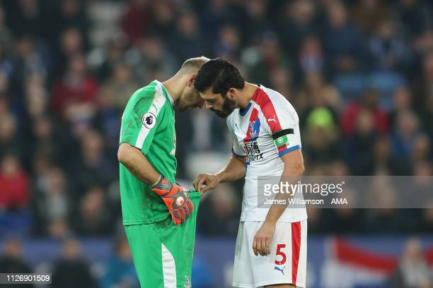 Vicente Guaita of Crystal Palace is inspected by James Tomkins of Crystal Palace during the Premier League match between Leicester City and Crystal...