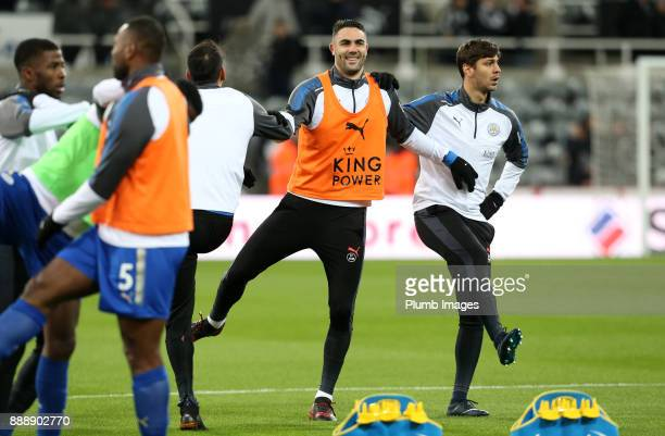 Vicente Iborra and Aleksandar Dragovic of Leicester City warm up at St James Park ahead of the Premier League match between Newcastle United and...