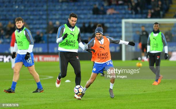 Vicente Iborra and Riyad Mahrez of Leicester City warm up at King Power Stadium ahead of the FA Cup fifth round match between Leicester City and...
