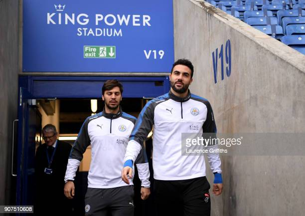 Vicente Iborra of Leicester City and Aleksander Dragovic of Leicester City arrive at the stadium prior to the Premier League match between Leicester...