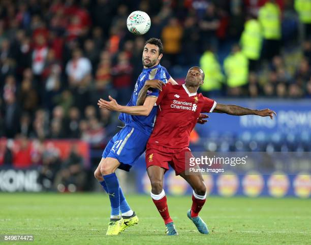 Vicente Iborra of Leicester City and Georginio Wijnaldum of Liverpool compete for the ball during the Carabao Cup third round match between Leicester...