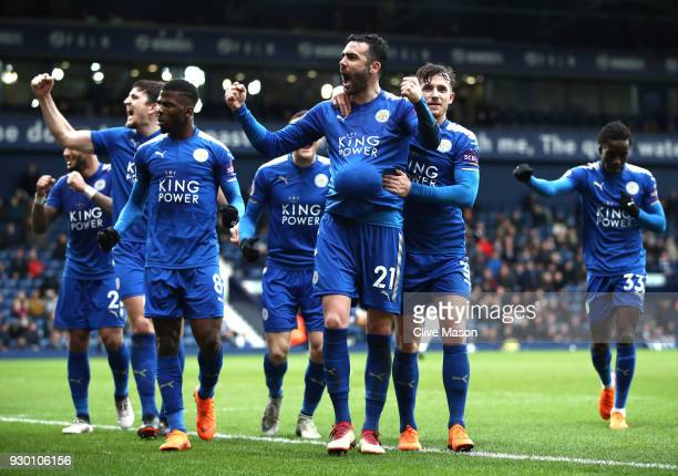 Vicente Iborra of Leicester City celebrates after scoring his sides fourth goal with his Leicester City team mates during the Premier League match...