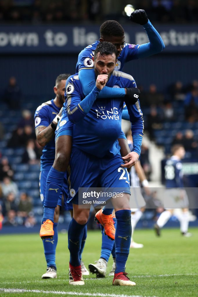 Vicente Iborra of Leicester City celebrates after scoring his sides fourth goal with Kelechi Iheanacho of Leicester City during the Premier League match between West Bromwich Albion and Leicester City at The Hawthorns on March 10, 2018 in West Bromwich, England.