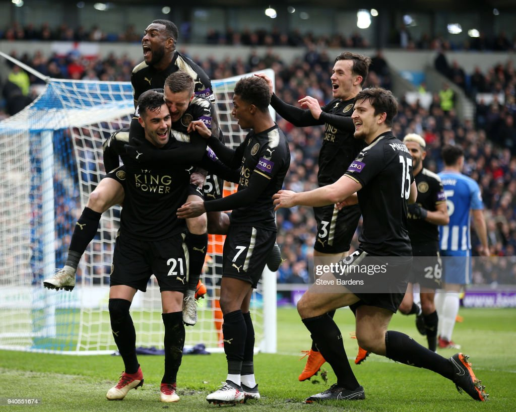 Vicente Iborra of Leicester City (left) celebrates with team after scoring his sides first goal during the Premier League match between Brighton and Hove Albion and Leicester City at Amex Stadium on March 31, 2018 in Brighton, England.