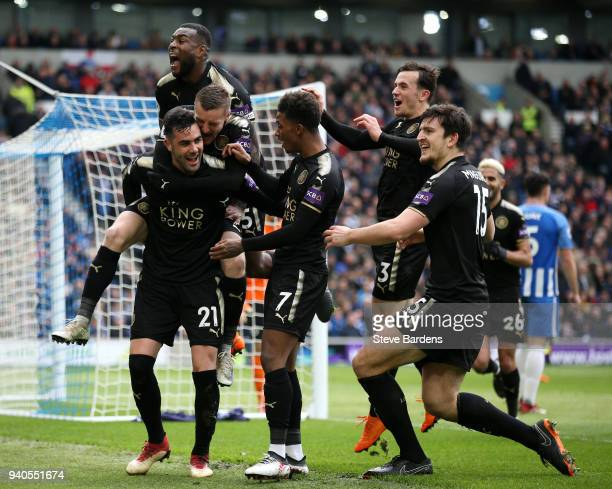 Vicente Iborra of Leicester City celebrates with team after scoring his sides first goal during the Premier League match between Brighton and Hove...