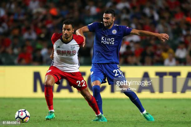 Vicente Iborra of Leicester City challenges Nacer Chadli of West Bromwich during the Premier League Asia Trophy match between Leicester City and West...