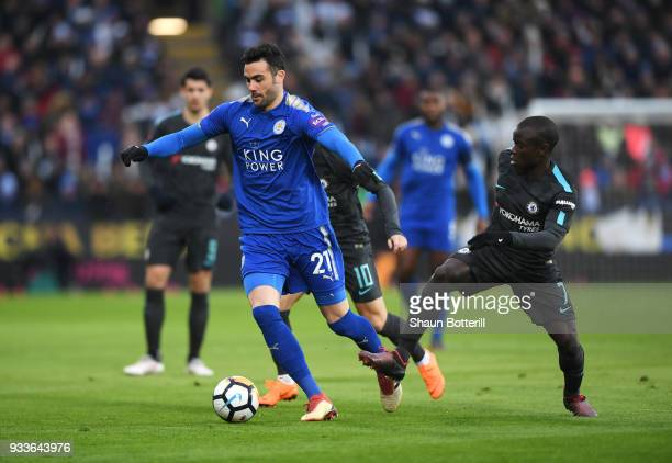 Vicente Iborra of Leicester City evades N'Golo Kante of Chelsea during The Emirates FA Cup Quarter Final match between Leicester City and Chelsea at...