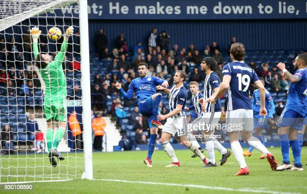 Vicente Iborra of Leicester City heads the ball past Ben Foster of West Bromwich Albion to make it 14 during the Premier League match between West...