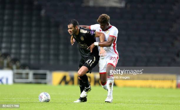 Vicente Iborra of Leicester City in action with Aaron Tshibola of MK Dons during the pre season friendly between MK Dons and Leicester City on July...