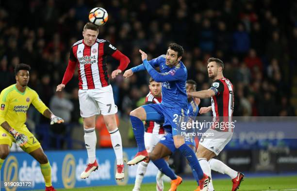Vicente Iborra of Leicester City in action with John Lundstram of Sheffield United during the FA Cup fifth round match between Leicester City and...