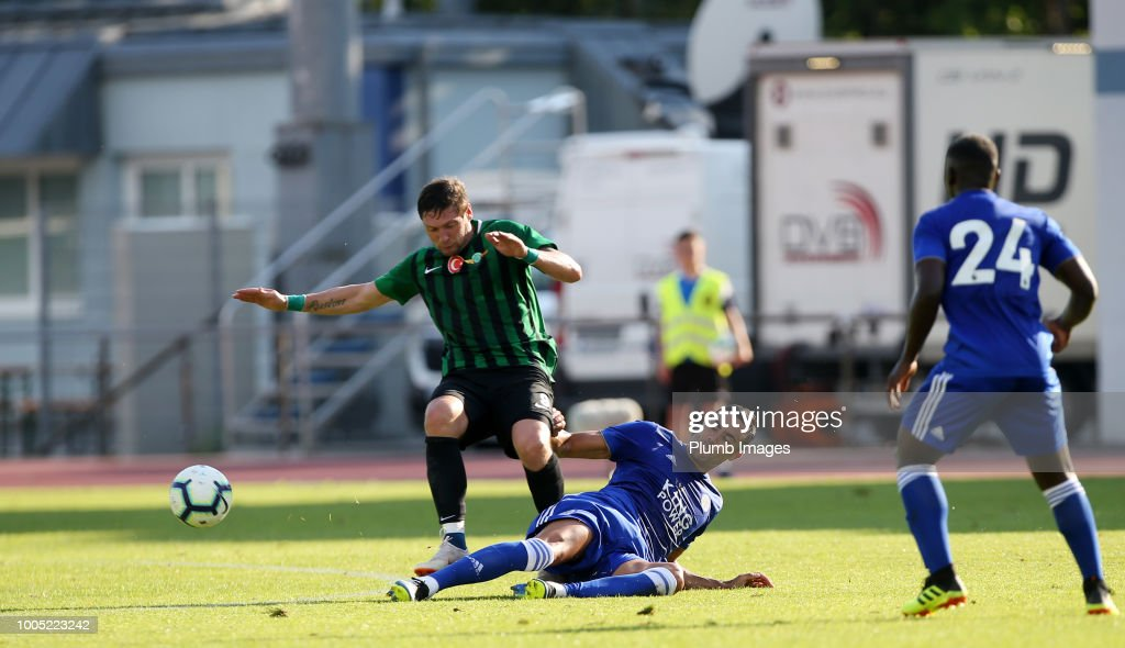 Vicente Iborra of Leicester City in action with Yevgen Seleznov of Akhisarspor during the pre-season friendly match between Leicester City and Akhisarspor at Stadion Villach on July 25th, 2018 in Villach, Austria.