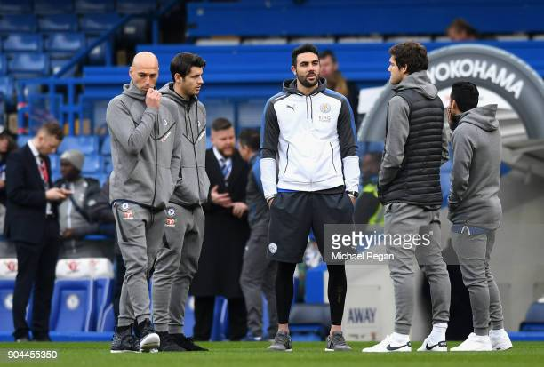Vicente Iborra of Leicester City speaks with the Chelsea team on the pitch prior to the Premier League match between Chelsea and Leicester City at...