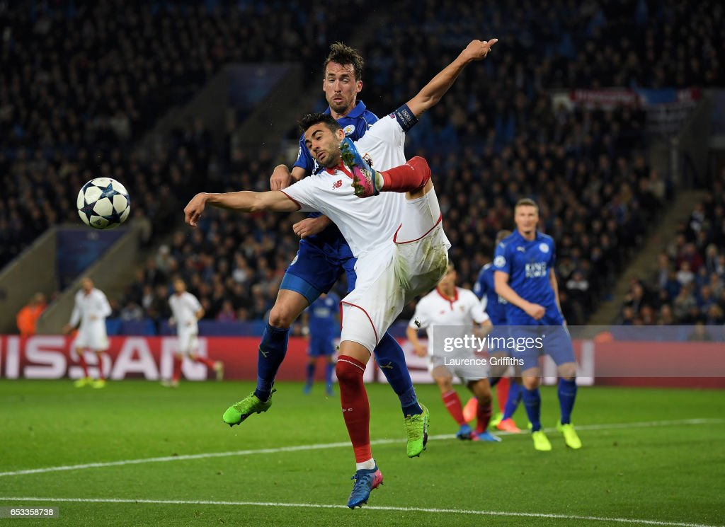 Vicente Iborra of Sevilla and Christian Fuchs of Leicester City battle for the ball during the UEFA Champions League Round of 16, second leg match between Leicester City and Sevilla FC at The King Power Stadium on March 14, 2017 in Leicester, United Kingdom.