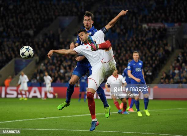 Vicente Iborra of Sevilla and Christian Fuchs of Leicester City battle for the ball during the UEFA Champions League Round of 16 second leg match...