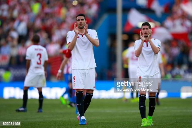 Vicente Iborra of Sevilla FC and his teammate Sergio Escudero acknowledge their fans after the La Liga match between Club Atletico de Madrid and...