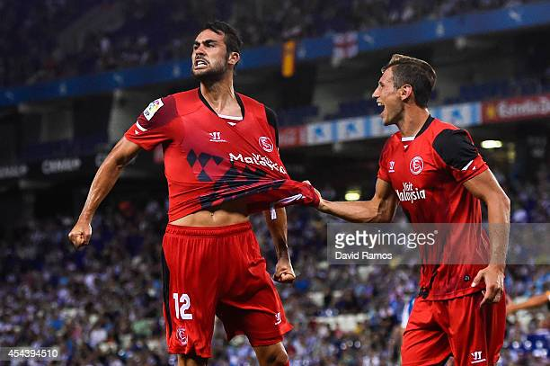 Vicente Iborra of Sevilla FC celebrates with his teammate Grzegorz Krychowiak after scoring the opening goalduring the La Liga Match between RCD...