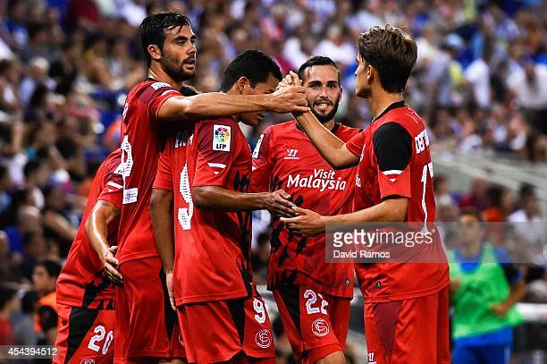 Vicente Iborra of Sevilla FC celebrates with his teammates after scoring the opening goal during the La Liga Match between RCD Espanyol and Sevilla...