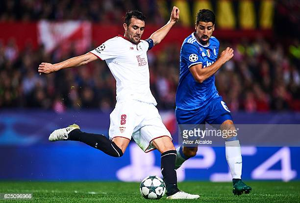 Vicente Iborra of Sevilla FC competes for the ball with Sami Khedira of Juventus during the UEFA Champions League match between Sevilla FC and...