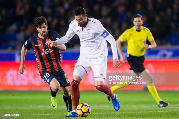 Vicente Iborra of Sevilla FC duels for the ball with Manuel Garcia of Deportivo Alaves during the La Liga match between Deportivo Alaves and Sevilla...