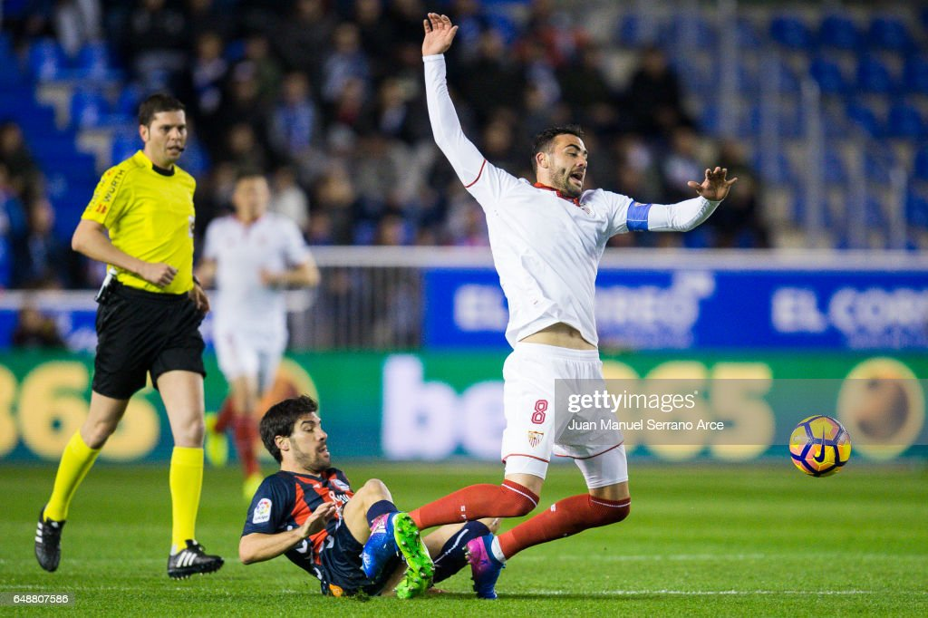 Vicente Iborra of Sevilla FC duels for the ball with Manuel Garcia of Deportivo Alaves during the La Liga match between Deportivo Alaves and Sevilla FC at Mendizorroza stadium on March 6, 2017 in Vitoria-Gasteiz, Spain.