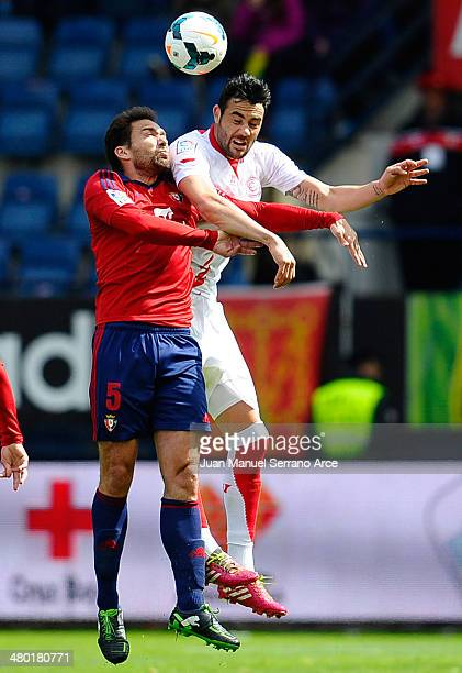 Vicente Iborra of Sevilla FC duels for the ball with Manuel Jesus Ortiz 'Lolo' of CA Osasuna during the La Liga match between CA Osasuna and Sevilla...