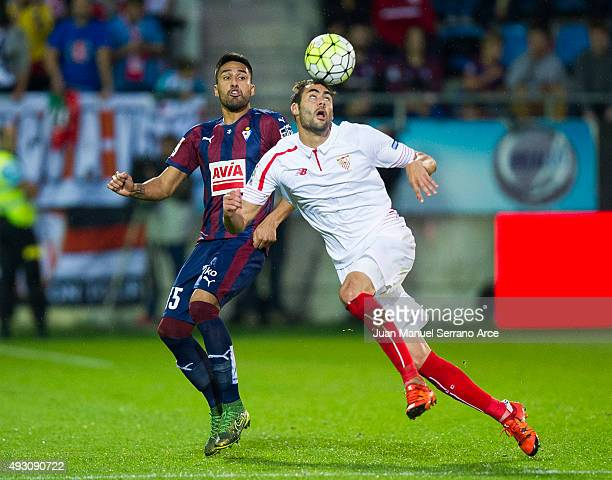Vicente Iborra of Sevilla FC duels for the ball with Vicente Iborraof SD Eibar during the La Liga match between SD Eibar and Sevilla FC at Ipurua...