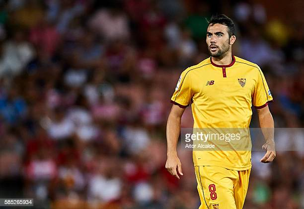 Vicente Iborra of Sevilla FC looks on during a friendly match between Granada FC and Sevilla FC at Estadio Nuevo los Carmenes on August 2 2016 in...