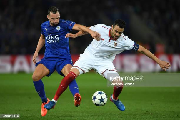 Vicente Iborra of Sevilla is challenged by Danny Drinkwater of Leicester City during the UEFA Champions League Round of 16 second leg match between...