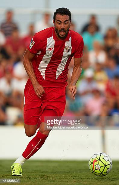 Vicente Iborra of Sevilla runs with the ball during a Pre Season Friendly match between Sevilla and Alcorcon at Pinatar Arena Stadium on July 19 2015...