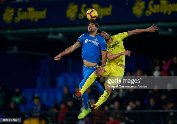 Vicente Iborra of Villarreal CF competes for the ball with Mata of Getafe CF during the La Liga match between Villarreal CF and Getafe CF at Estadio...