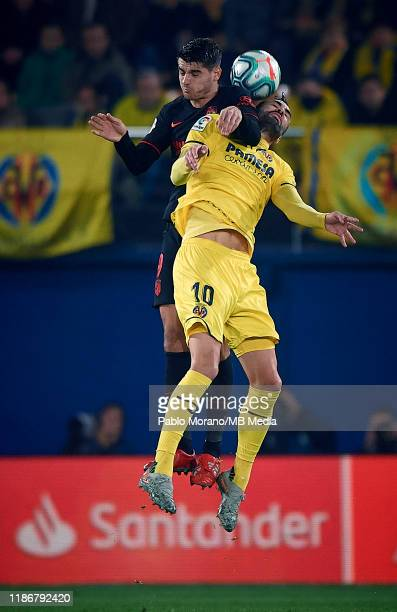 Vicente Iborra of Villarreal competes for the ball with Alvaro Morata of Atletico de Madrid during the Liga match between Villarreal CF and Club...