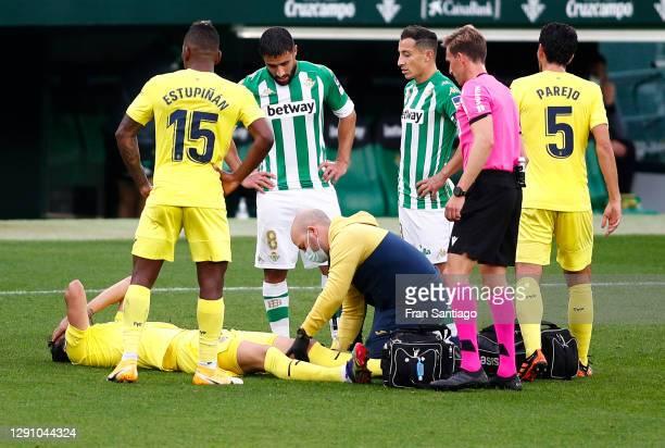 Vicente Iborra of Villarreal receives medical attention during the La Liga Santander match between Real Betis and Villarreal CF at Estadio Benito...