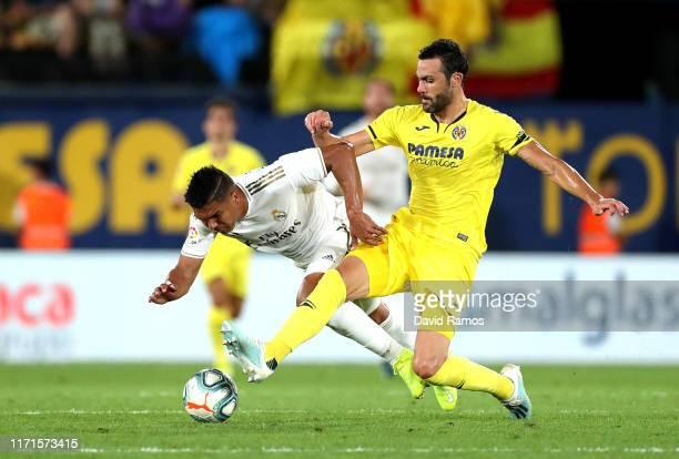 Vicente Iborra of Villarreal tackles Casemiro of Real Madrid during the Liga match between Villarreal CF and Real Madrid CF at Estadio de la Ceramica...